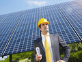 Businessman and solar panels Stock Photo