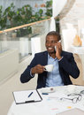Businessman speaking over mobile phone Royalty Free Stock Photo