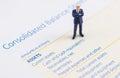 Businessman stand on the balance sheet
