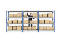 A businessman standing behind a metal warehouse rack full of boxes on white background. Royalty Free Stock Photo