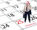 Businessman standing on christmas calendar Royalty Free Stock Photography