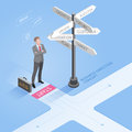 Businessman standing  at a crossroad and looking directional signs Royalty Free Stock Photo