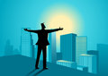 Businessman standing on the edge of a building