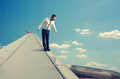 Businessman standing on edge of the wing frightened Royalty Free Stock Photo