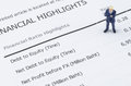 Businessman standing on the financial highlight in ann miniature annual report Royalty Free Stock Photo