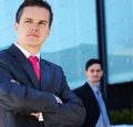 A businessman standing in front of his colleague Stock Photos