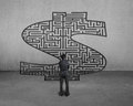 Businessman standing in front of money symbol maze Stock Photos