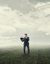 Businessman Standing Growing Flower Royalty Free Stock Photo