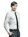 Businessman standing with his hands in the pockets young Stock Photos