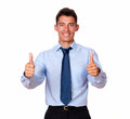 Businessman standing with his thumbs up a portrait of a on blue shirt and smiling at you on isolated background Royalty Free Stock Photos