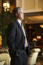 image photo : Businessman standing in hotel lobby.