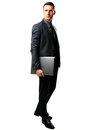 Businessman standing with laptop full length portrait of a isolated on a white background Stock Photos