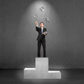 Businessman standing on podium throwing and catching d money sy sliver symbols Royalty Free Stock Photo