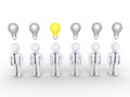 Businessman stands out of others with lightbulb businessmen standing lightbulbs over them but only one is lit Royalty Free Stock Images