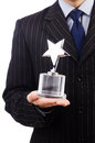 Businessman with star award isolated on white Stock Photo