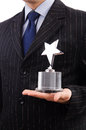 Businessman with star award isolated on white Royalty Free Stock Photos