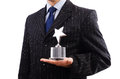Businessman with star award isolated on white Stock Images