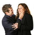 Businessman strangling a businesswoman Stock Images