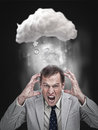 Businessman stressing out under a cloud for computing with application icons Stock Photography