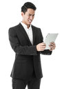 Businessman struggling to use a tablet in black suit Royalty Free Stock Photos
