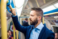 Businessman in subway young handsome with smartphone Stock Photo