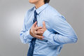 Businessman suffer from heart attack with gray background Royalty Free Stock Photo