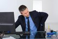 Businessman suffering from backpain Royalty Free Stock Photo