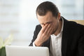 Businessman suffering from eyes fatigue at work Royalty Free Stock Photo