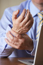 Businessman suffering from repetitive strain injury rsi suffers Royalty Free Stock Photography