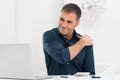 Businessman Suffering From Shoulder Pain Royalty Free Stock Photo