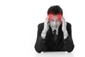 Businessman suffers from sickness severe headache with red alert accent Royalty Free Stock Image