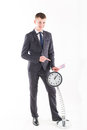 Businessman in a suit and a grandfather clock handsome man Royalty Free Stock Images