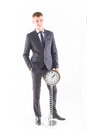 Businessman in a suit and a grandfather clock handsome man Stock Photography