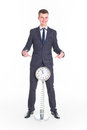 Businessman in a suit and a grandfather clock handsome man Stock Image