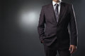 Businessman in suit on gray background this image has attached release Stock Photos