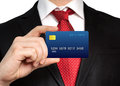 Businessman in a suit holding a credit card Royalty Free Stock Photo