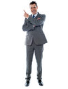 Businessman in suit pointing at copyspace Royalty Free Stock Photo