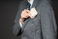 Businessman in suit putting banknotes in his jacket breast pocket.  Business man is holding cash, stack of fifty euros money. Pers Royalty Free Stock Photo
