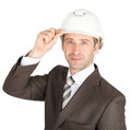 Businessman in suit raised his hard hat to greet smiling camera on white background Royalty Free Stock Photography
