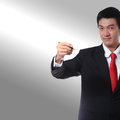 Businessman in a suit with a red tie color holding a pen and writing something. Royalty Free Stock Photo