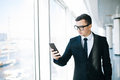Businessman in suit use mobile phone to check email or write message in office room Royalty Free Stock Photo