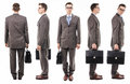 Businessman with suitcase from all sides Royalty Free Stock Photo