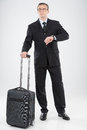 Businessman with suitcase full length of confident middle age man in crying and looking away Royalty Free Stock Images