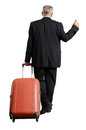 Businessman with suitcase is hiking back view of isolated on white background Stock Photo