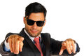 Businessman with sunglasses pointing portrait of a over white background Royalty Free Stock Photography