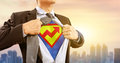 Businessman in superhero costume with rising graph Royalty Free Stock Photo