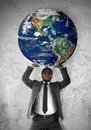 Businessman sustains the planet Earth Royalty Free Stock Photo