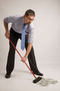 Businessman is sweeping money