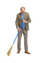 Businessman sweeps a floor on a white background Royalty Free Stock Photo