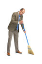 Businessman sweeps a floor on a white background Stock Photo